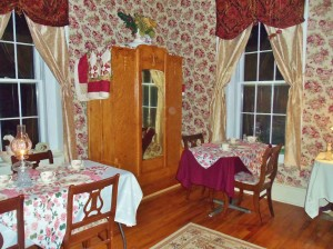 Aunt Rena's Room – Aunt Rena's room is located on the main level of the Inn. It is in the back of the house and has a fireplace, double bed, private bath with shower tub unit in the room. This room can also be changed into a dining room, craft room or meeting room.